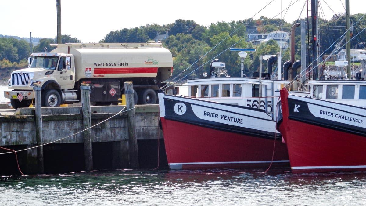 A Petro-Canada truck refueling a boat