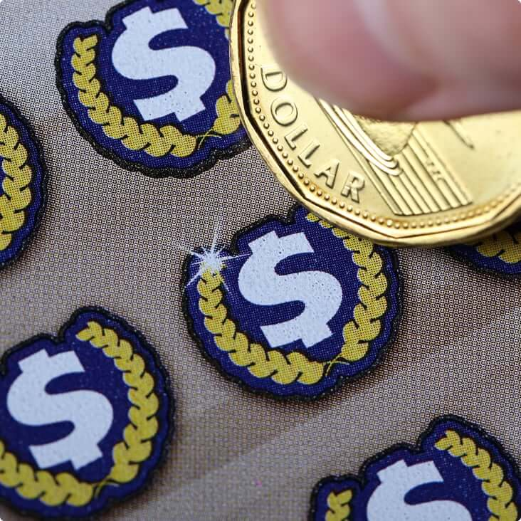 A loonie scratching a lottery ticket