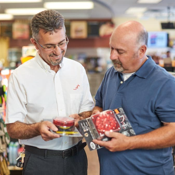 Two men in a Petro-Canada store looking at products together