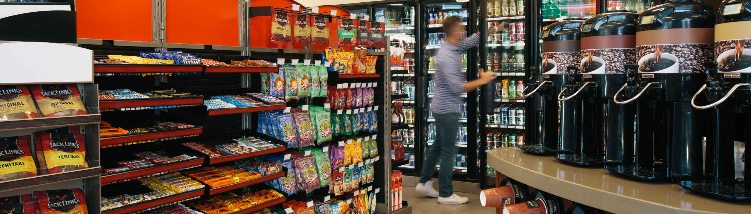 A man grabbing a drink from a Petro-Canada store.