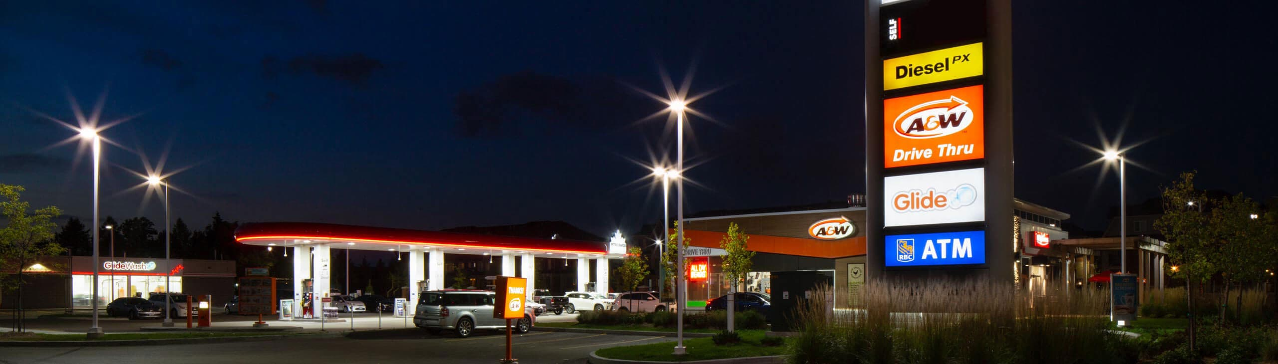 A Petro-Canada gas station at night.
